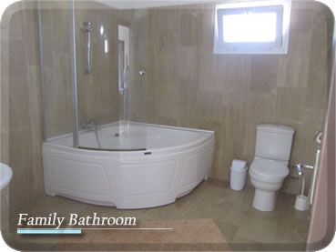 shower over corner bath. A Large Bathroom Having White Suite Featuring Corner Bath With Shower  Ove Over home decor Xshare us
